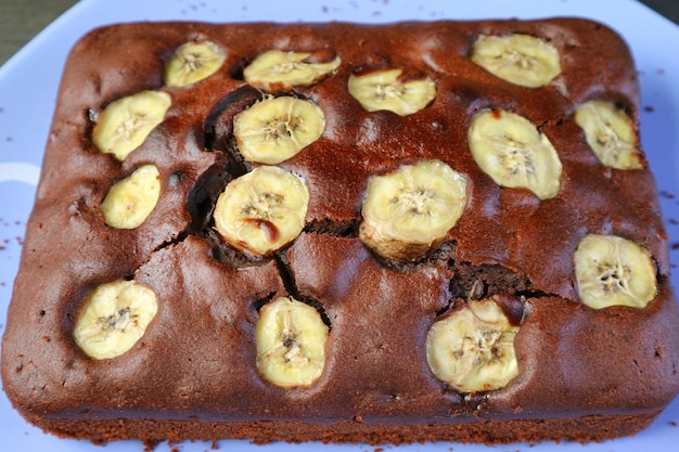 Flavorful homemade wholemeal chocolate banana cake on a blue plate