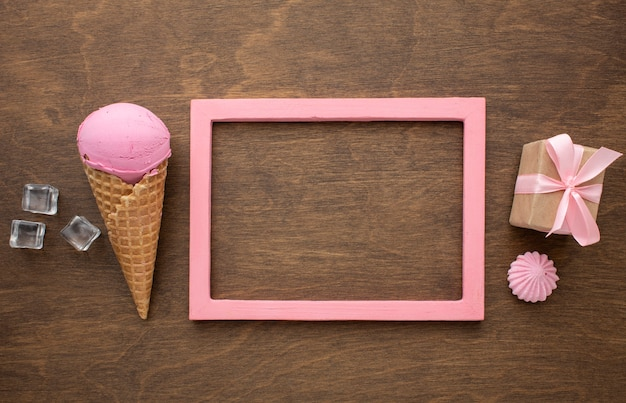 Flavoured ice cream on cone with frame and gift