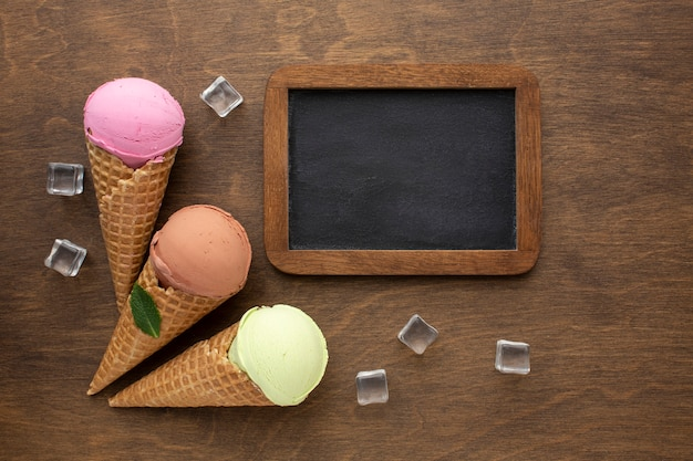 Flavoured ice cream on cones with chalkboard