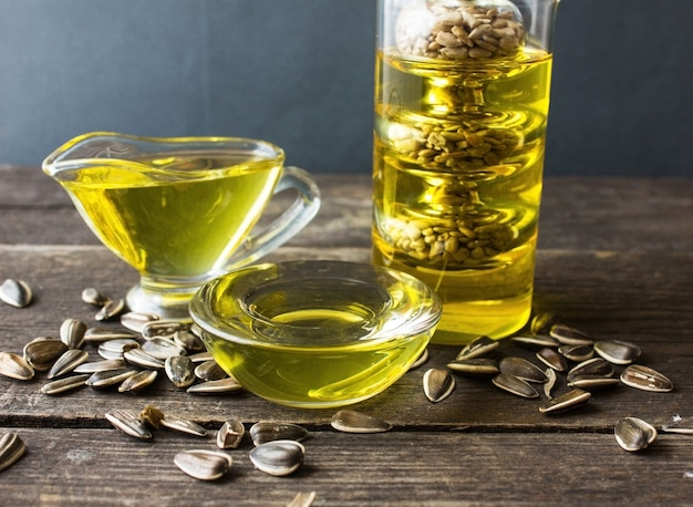 Flax oil with flax seeds on wooden background