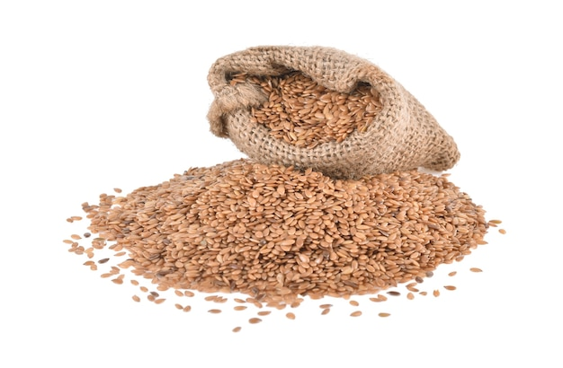 Flax seeds in bag isolated on white background.