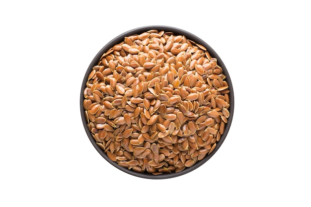 Flax seeds in clay bowl isolated on white background