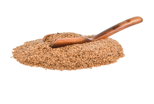 Flax seeds in a wooden spoon on white background