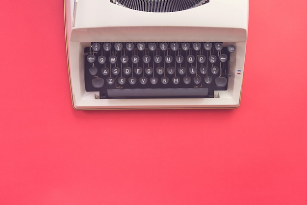 Flay design of typewriter on red background. retro style.