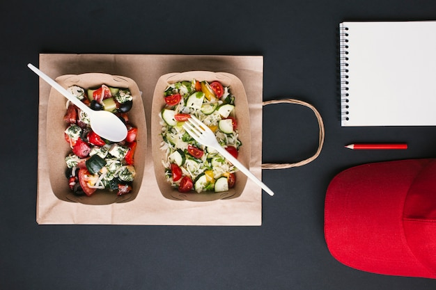 Flay lat arrangement with salads on paper bag