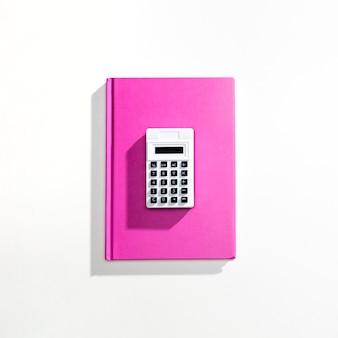Flay lay of calculator on book