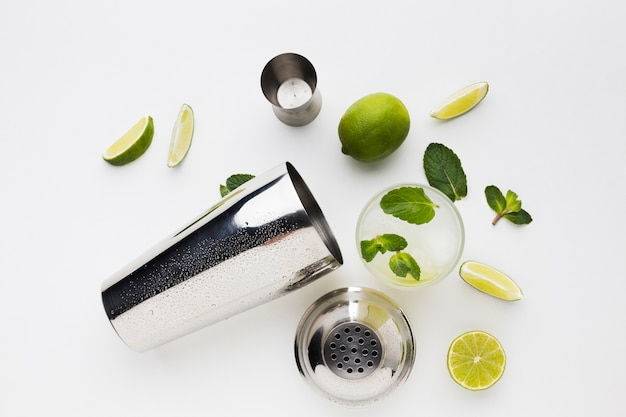 Flay lay of cocktail essentials with lime and mint