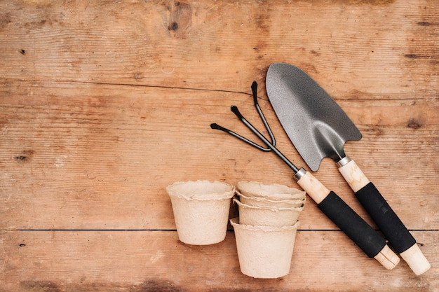 Flay lay gardening tools and flower pots