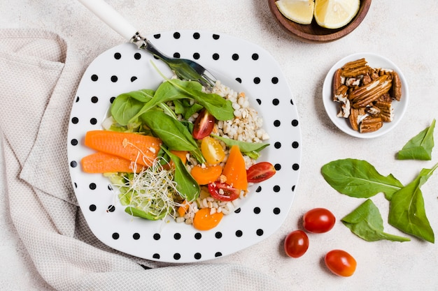 Flay lay of plate with salad and other healthy food
