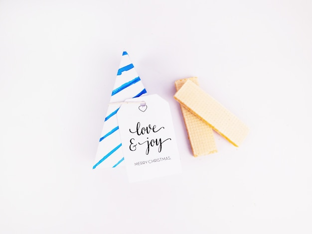 Flay lay style christmas decoration with triangle wafer christmas gift box and wafers