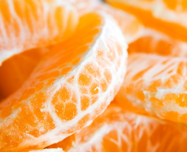 甘くて熟したオレンジのクローズアップの肉、有用な柑橘系の果物