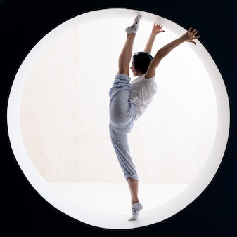 Flexible girl doing stretching in studio concept of willpower motivation and healthy lifestyle