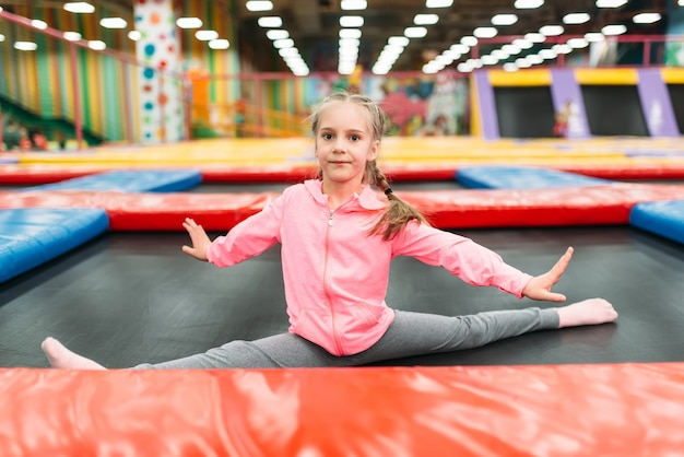 Flexible girl on playground in childrens entertainment center. child sport activity. happy childhood