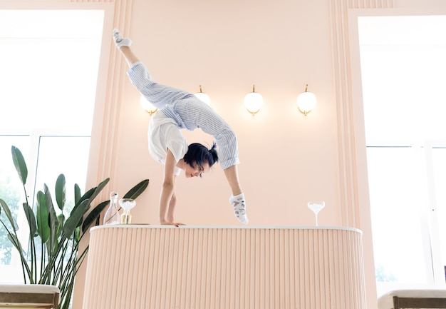 Flexible girl practice stretching and handstand at home concept of individuality creativity and selfconfidence