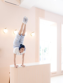 Flexible girl practice stretching and handstand at home concept of individuality creativity