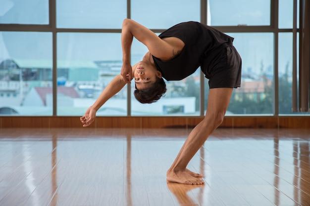 Flexible guy dancing in studio