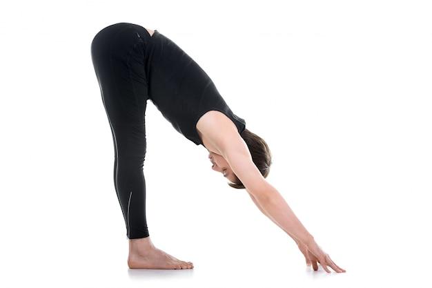 Flexible man doing yoga exercise