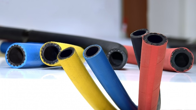 Flexible rubber cable on white background .rubber products .