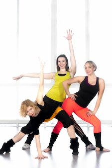 Flexible women in sportswear posing
