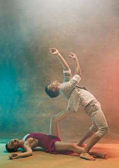 Flexible young modern dance couple