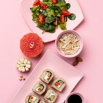 Flexitarian diet with salad and sushi flat lay