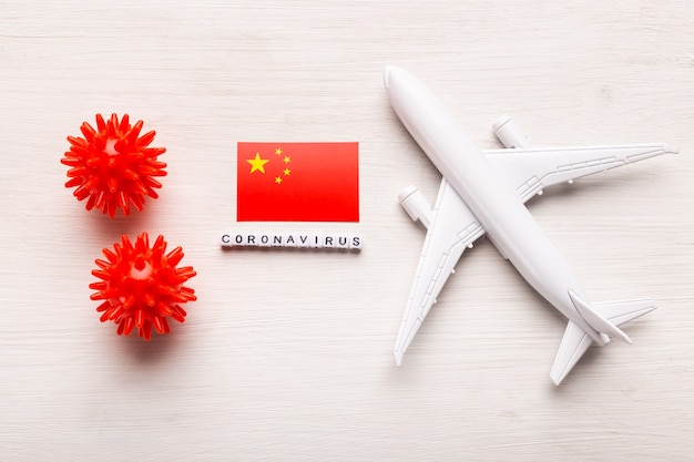 Flight ban and closed borders for tourists and travelers with coronavirus covid-19. airplane and flag of china on a white