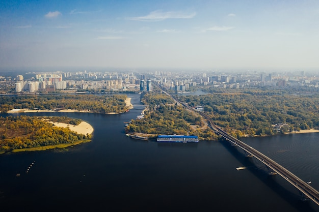 Flight over the bridge in kiev. aerial photography