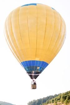 Flight on hot yellow air balloon