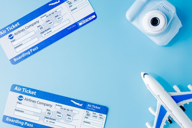 Flight tickets. camera, model of airplane and globe