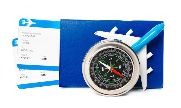 Flight tickets and compass on white background