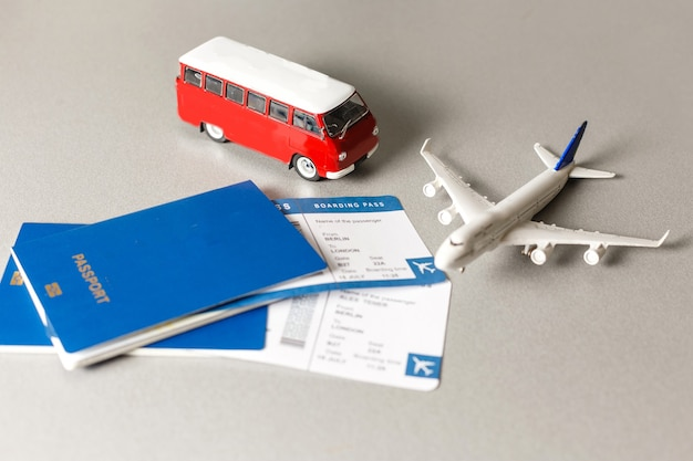 Flight tickets with passports, model of airplane, isolated on white background.