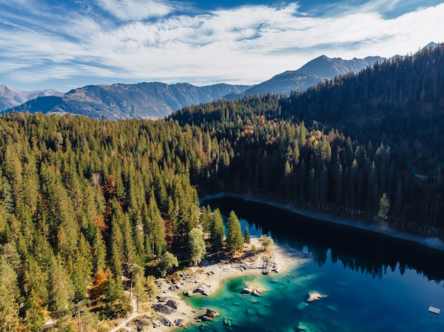 Flims lake at switzerland drone aerial, alpine mountains, sunny