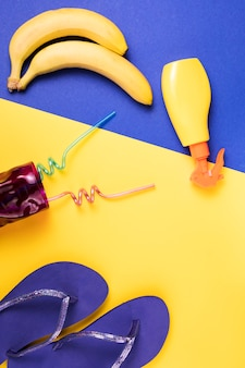Flip flops near spray and fruits with glass