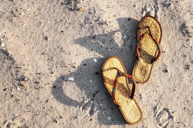 Flip flops on sand beach, baltic sea, germany. summer vacation concept, top view, flat lay