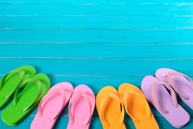 Flip flops on wooden blue background