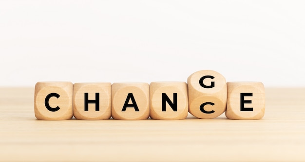 Flip wooden cube with word change to chance