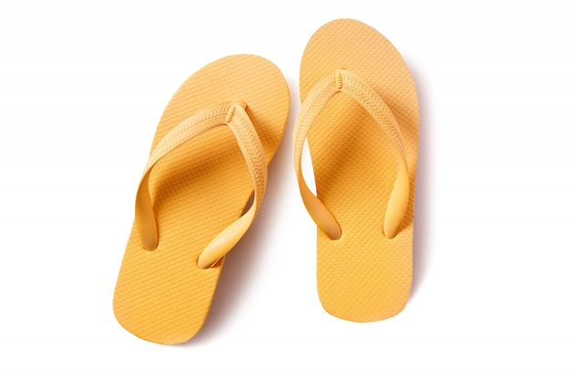 Flipflops 노란색 쌍 흰색 배경에 고립
