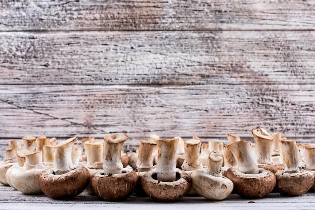 Flipped mushrooms on a wooden table. side view.