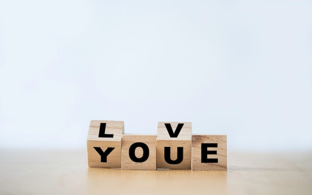 Flipping wooden block cube which print screen love you wording. valentines ' s day concept.
