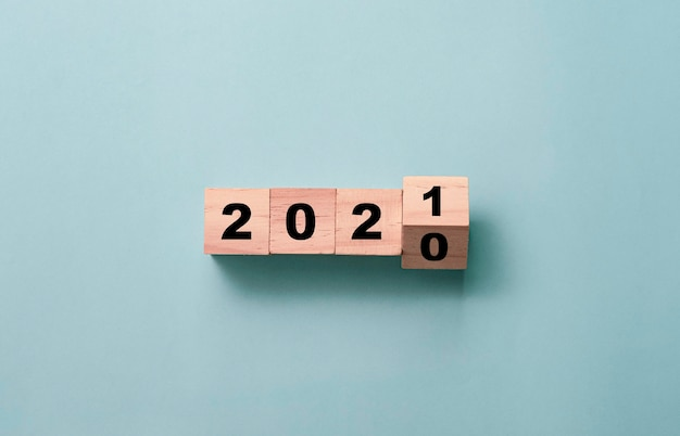 Flipping of wooden cubes block to change 2020 to 2021