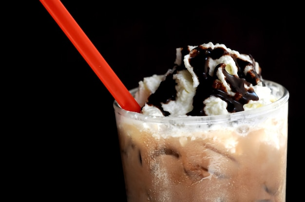 Float vanilla icecream on dark mocha smoothie
