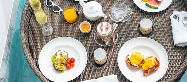 Floating breakfast tray in swimming pool at luxury hotel or tropical resort villa