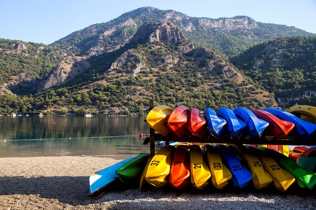 Floating in bright kayaks on the sea as an active leisure and sport