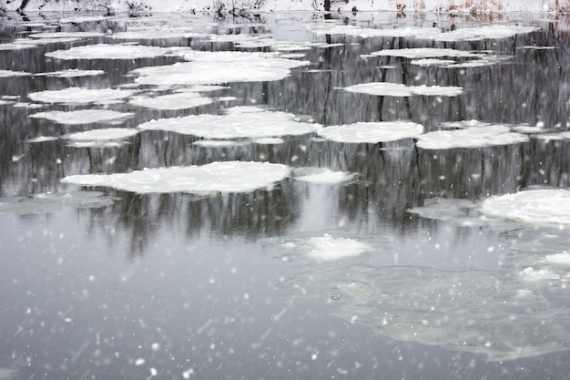 Floating grandfather on the winter river, winter landscape, spring floods