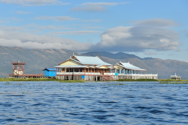 Floating house in inle village with beautiful blue sky in mandalay,myanmar