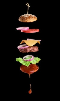 Floating ingredients of a cheeseburger