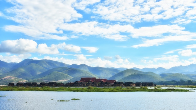 Floating inle people house on inle lake with beautiful sky,can use foe promote tourism in inla village in myanmar.