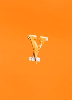Floating letter y background with dripping paint