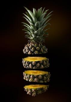 Floating pineapple slice isolated on dark background