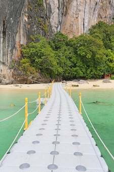 Floating pontoon footpath in the sea for go to the beach.